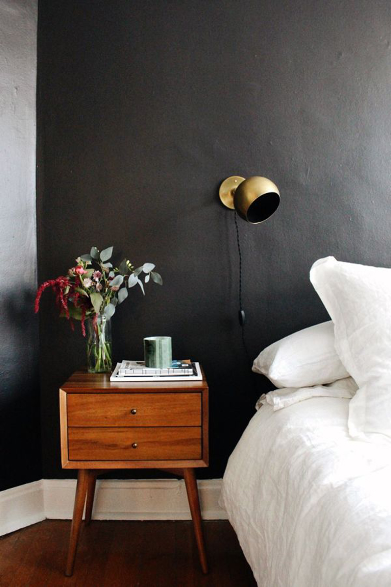 Brass Sconce against Black bedroom wall via Elise Joseph