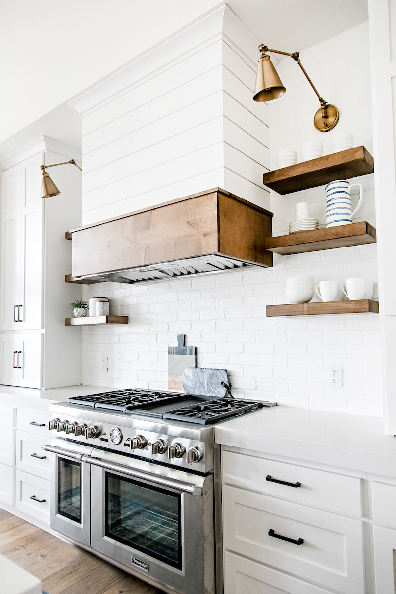 Brass sconces in white kitchen via Sita Montgomery