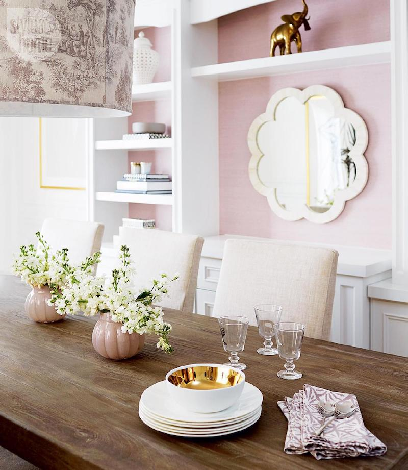 Dining room with pink wallpaper