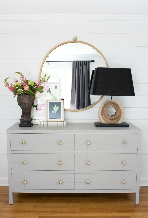 Gray wide dresser with metallic knobs