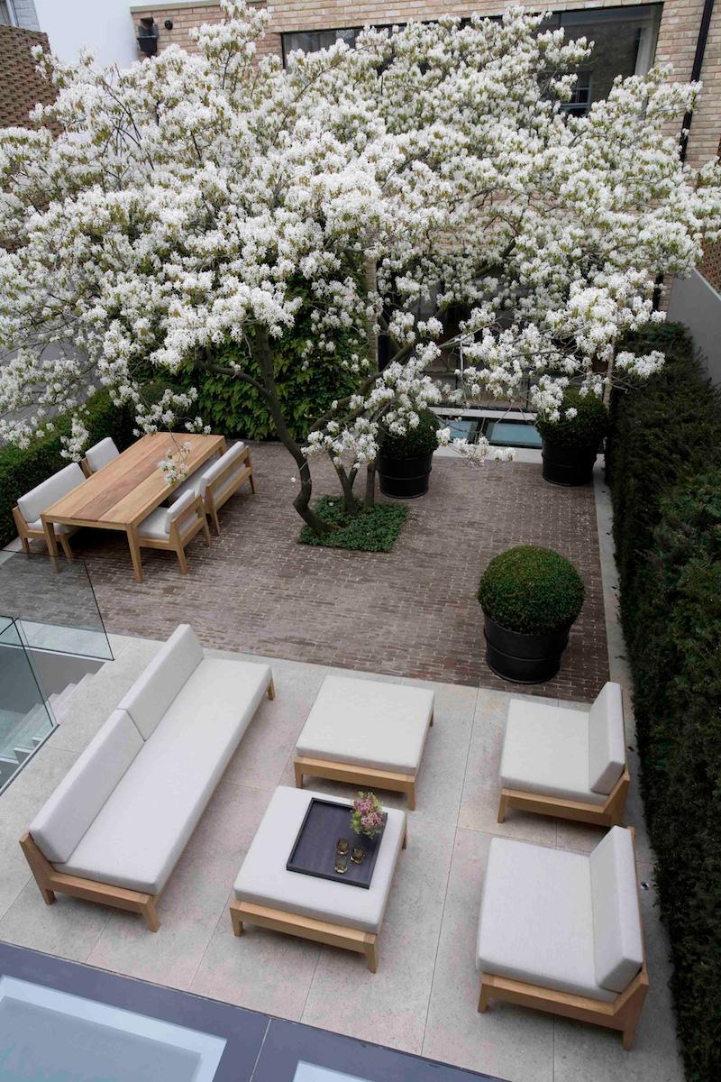 Grey and neutral patio chairs via Luciano Giubbilei