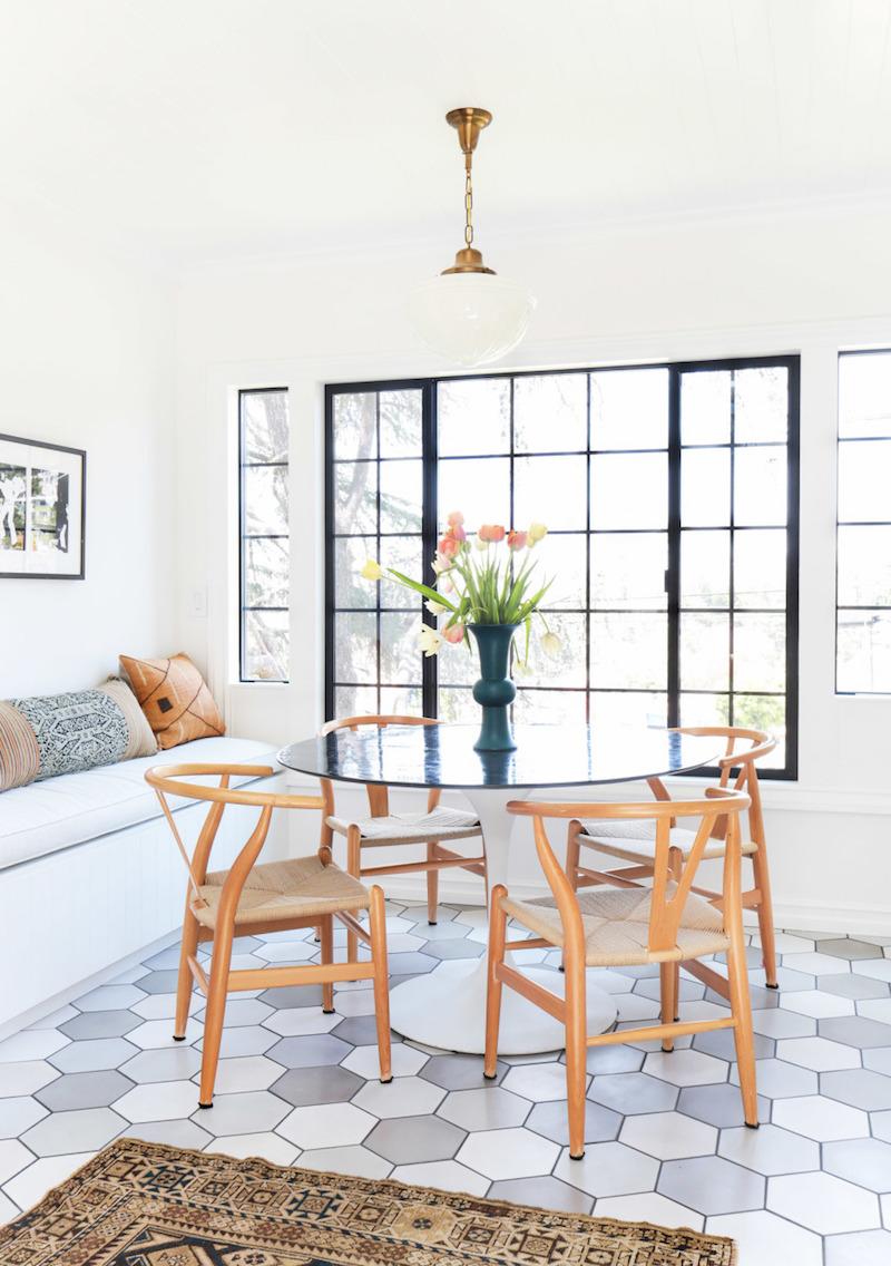 Natural wishbone chairs in breakfast nook via Homepolish