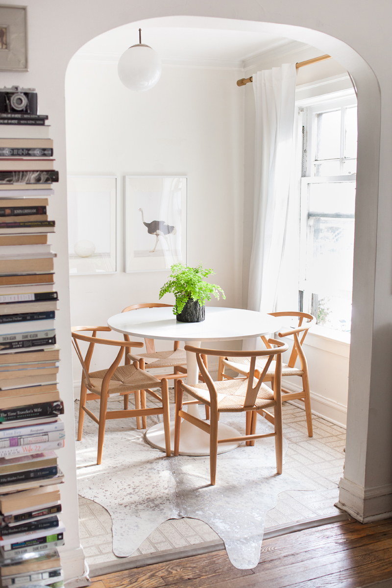 Neutral wishbone chairs in dining room via The Every Girl