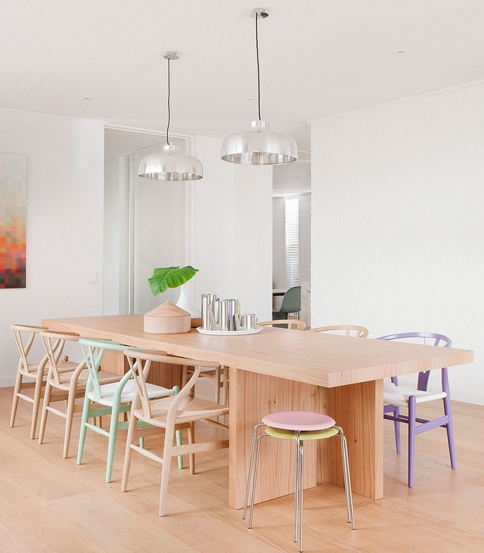 Pastel wishbone chairs in neutral dining room via Hecker Guthrie