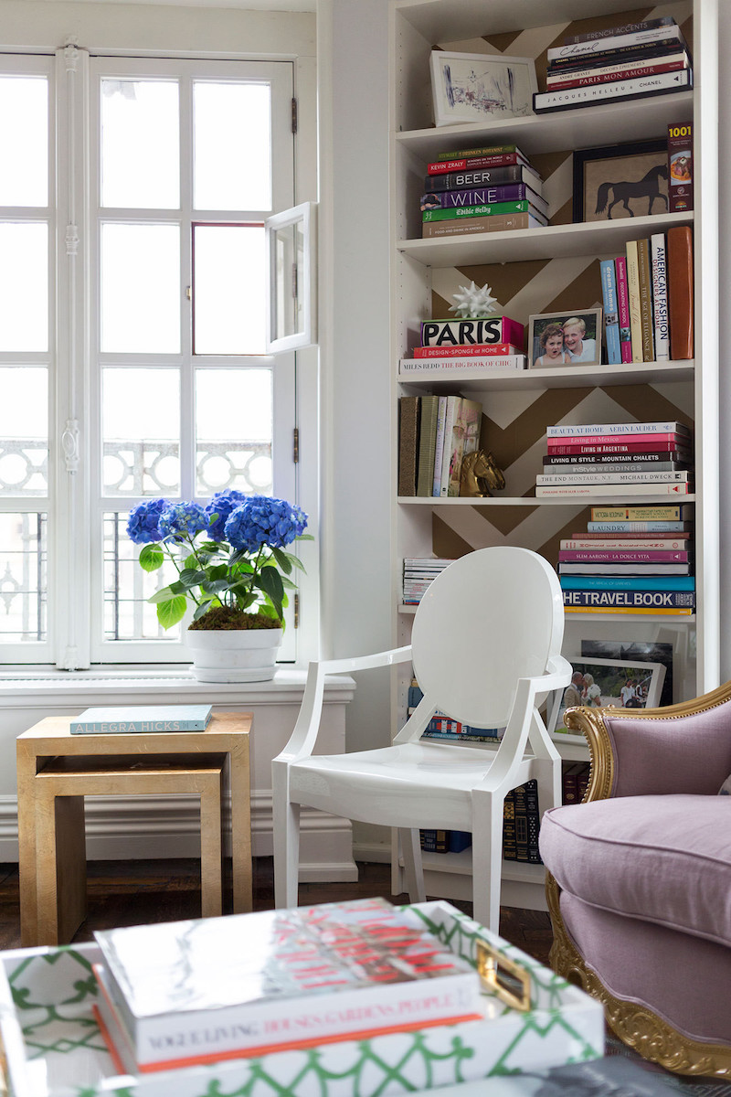 Solid white Louis chair against benches