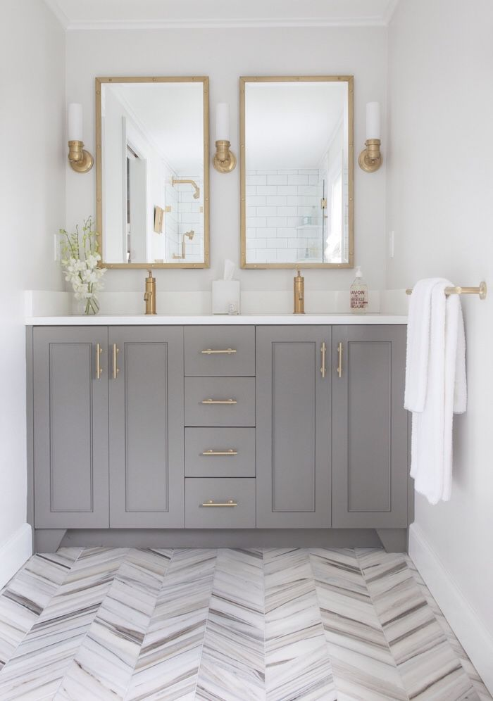 White And Gray Bathroom with Brass Scones and Double Vanity via Postbox Designs