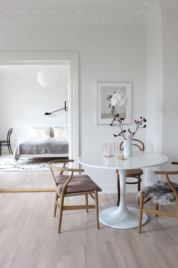 White tulip table with wishbone chairs via Scandinavian Love Song