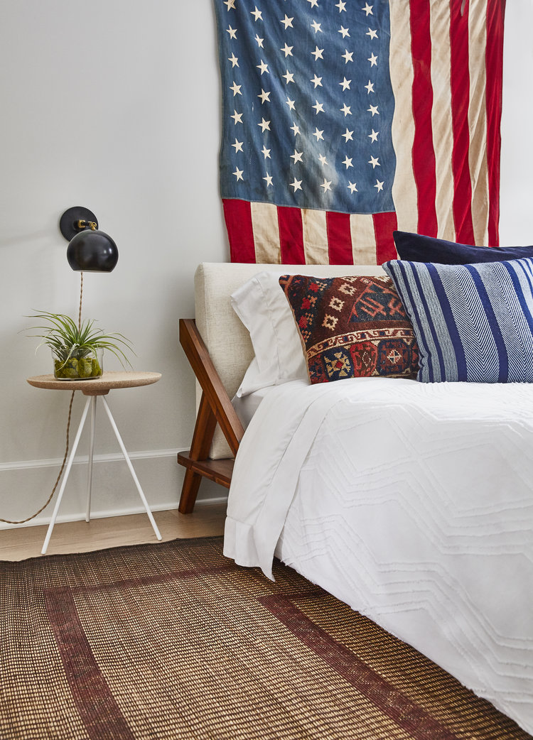 American flag behind bed via semikahtextiles