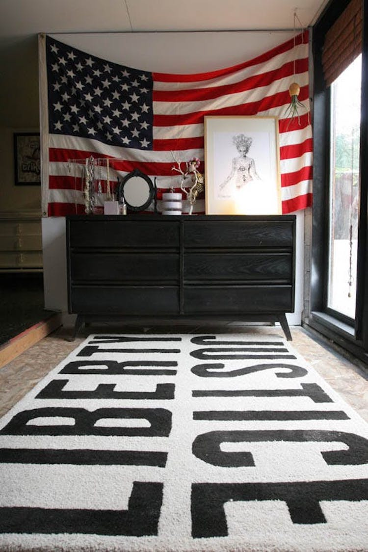 American flag behind black dresser via Apartment Therapy