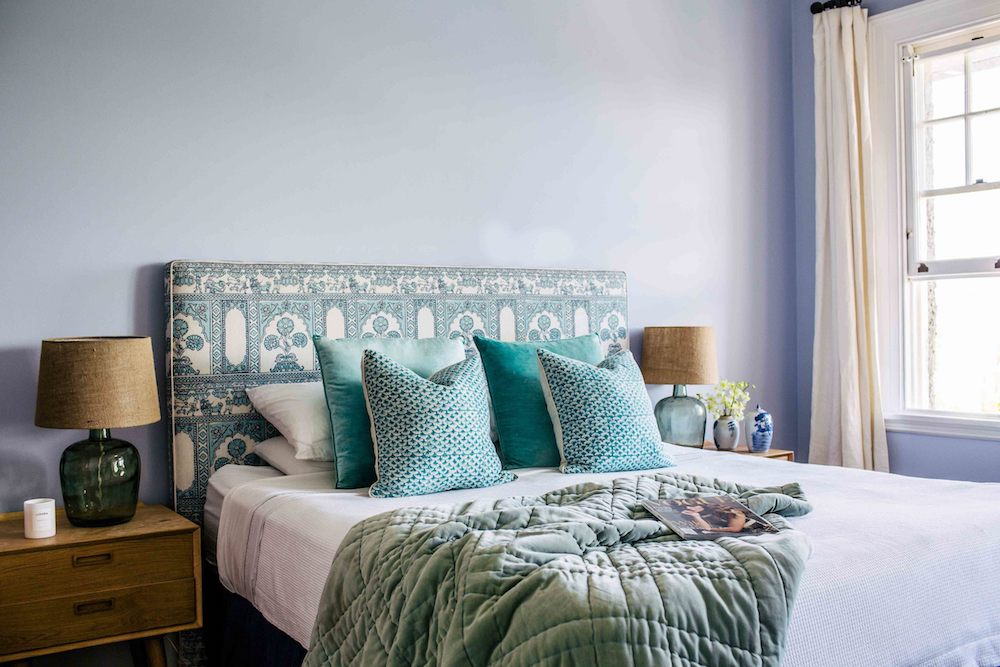 Bedroom with blue fabric headboard