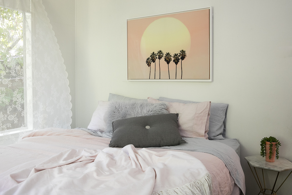 Bedroom with pink and sunset by Three Birds Renovations