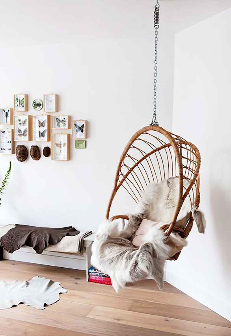 Brown rattan swing chair via Scent of Obsession