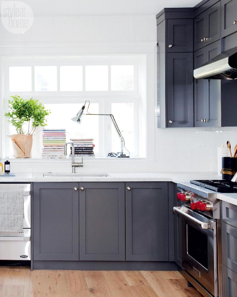 Dark grey cabinets in white kitchen