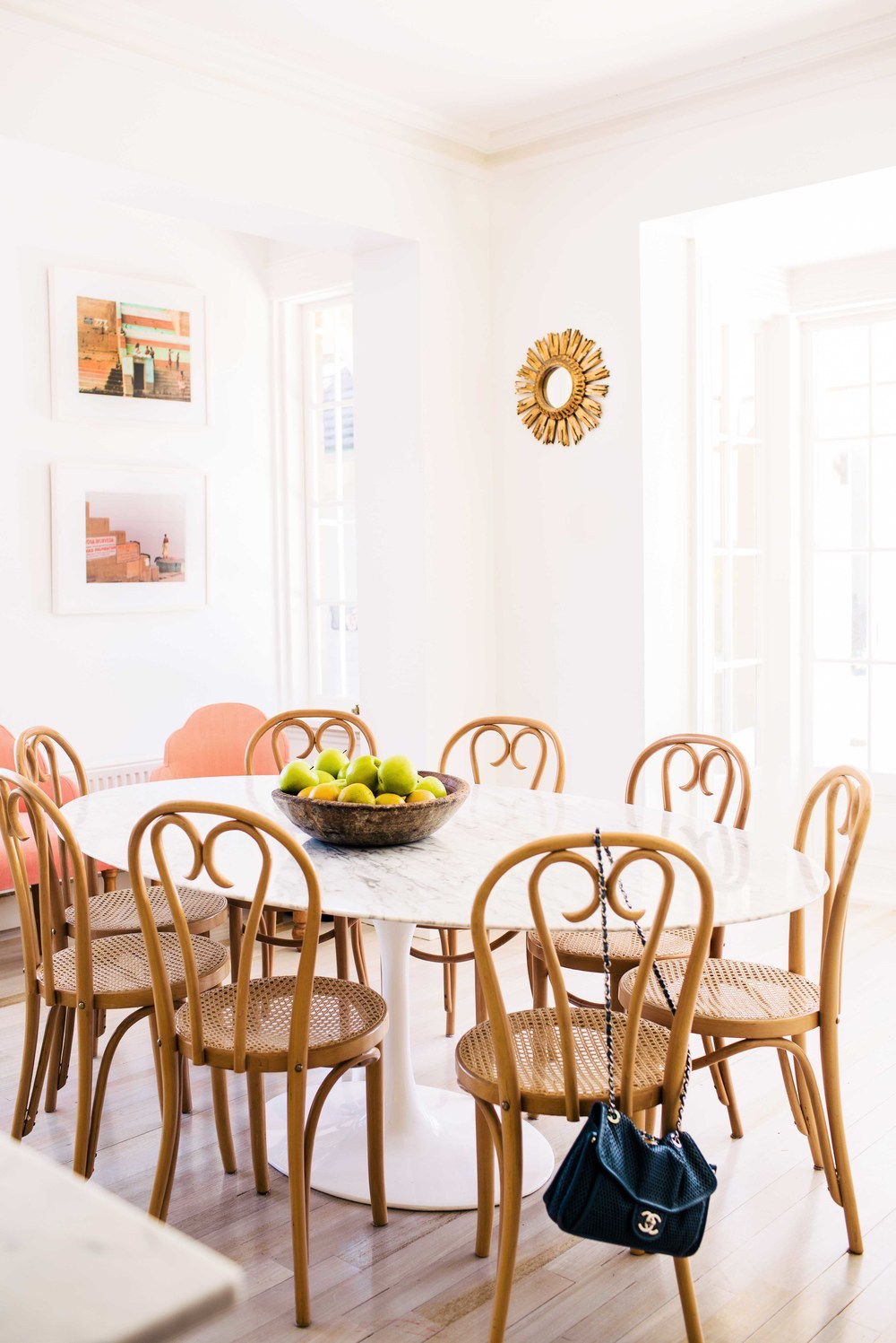 Dining room with bentwood chairs and marble table