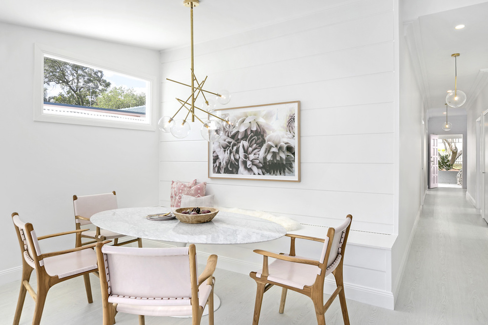 Dining room with marble table and pale pink chairs