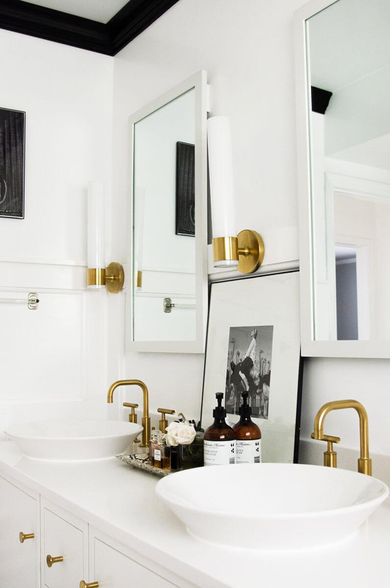 Double sink vanity with brass fixtures via Everygirl