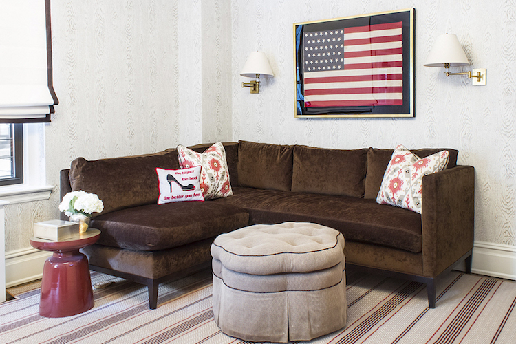 Framed American flag with brown sofa