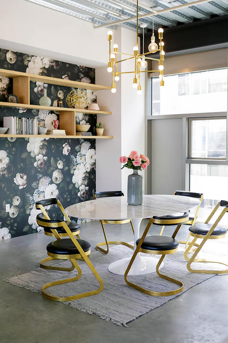 Gold chairs around white marble table