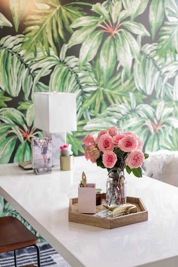 Green plant wallpaper with white desk office space