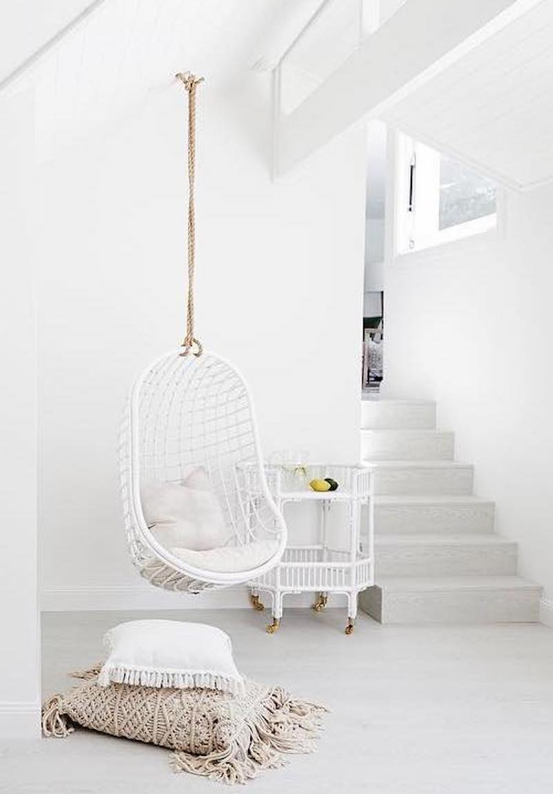 Hanging white chair via Three Birds Renovations