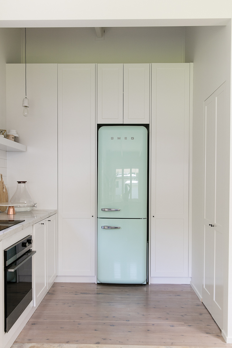 Kitchen with blue SMEG refrigerator