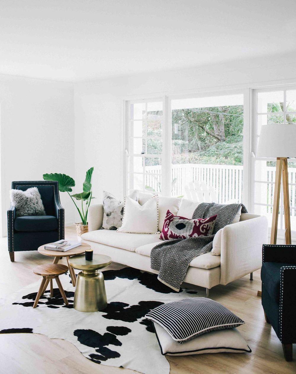 Living room with cream white couch and cowhide rug