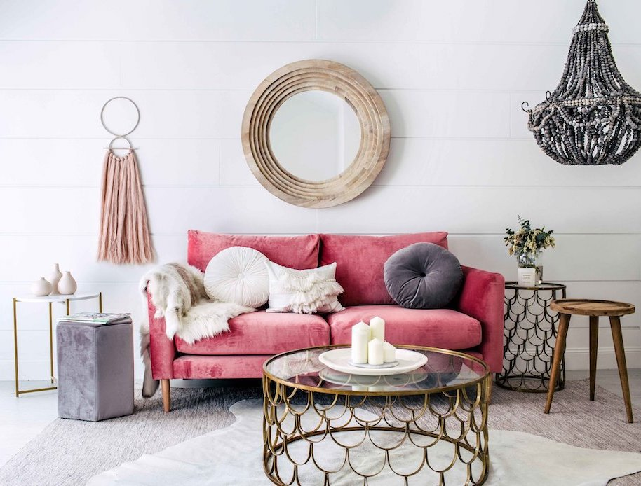 Living room with pink sofa via Three Birds Renovations