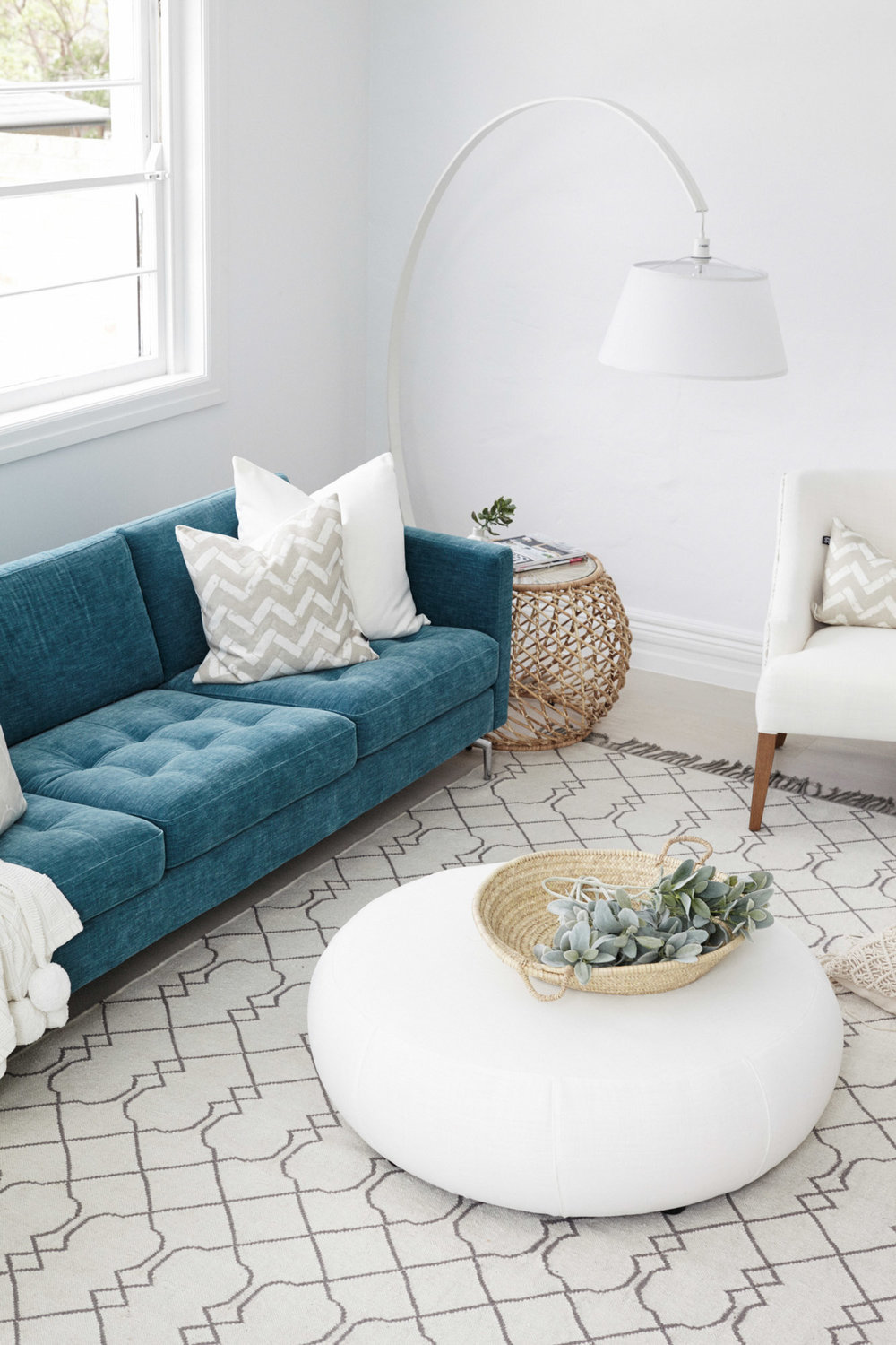 Living room with teal couch and overhang light