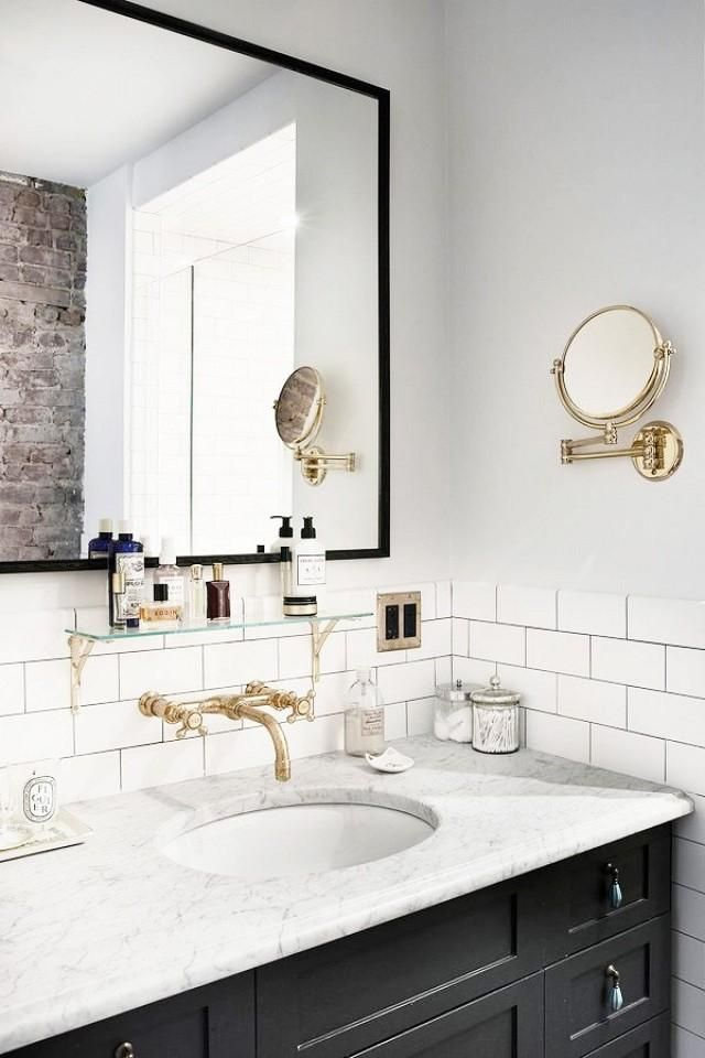 Marble bathroom counter with black cabinets via Pia Ulin for Vogue