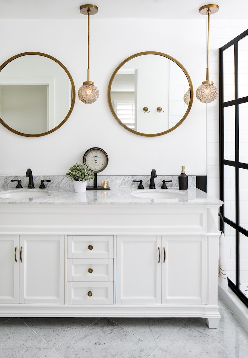 Marble bathroom vanity with gold mirror