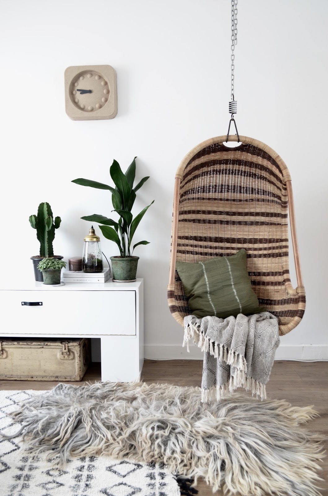 Natural and brown wicker hanging chair via By Milou