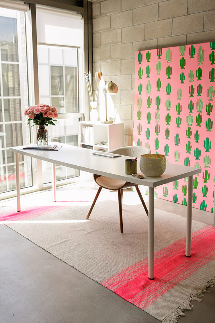 Pink cactus with neutral tones in bright office space