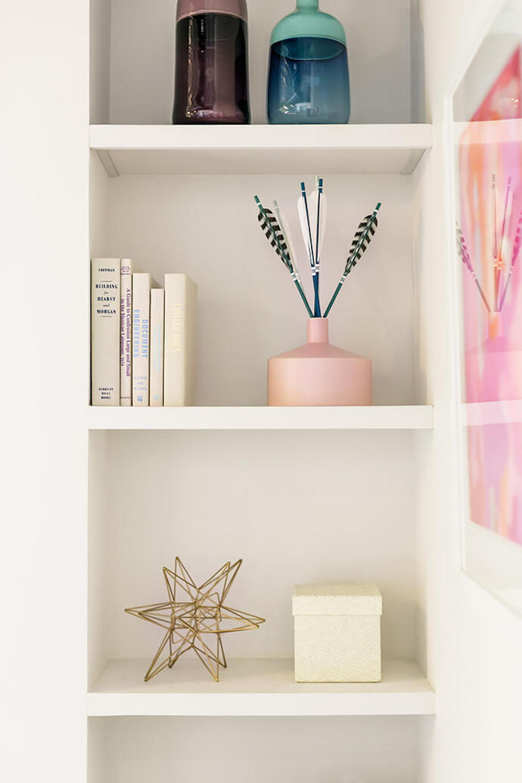 Styled white shelves in office space