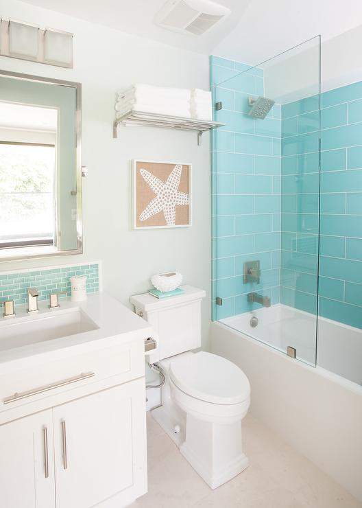 Turquoise subway tiling in a bathroom via AGK Design Studio