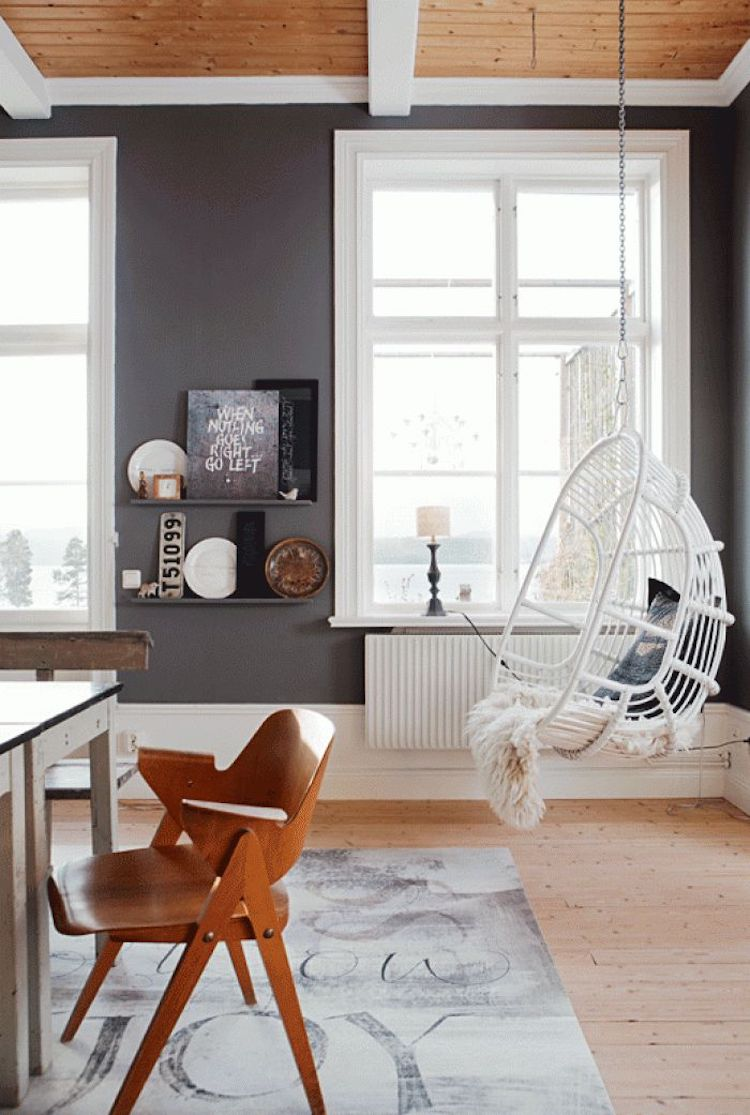 White hanging rattan chair in wood ceiling room