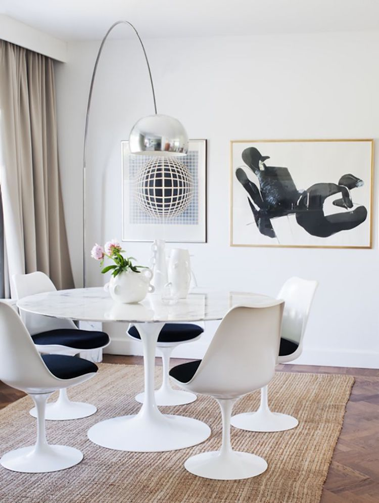 White marble tulip table with 60s chairs and arc floor lamp
