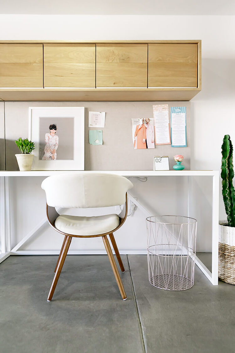 White mid-century desk chair in neutral space