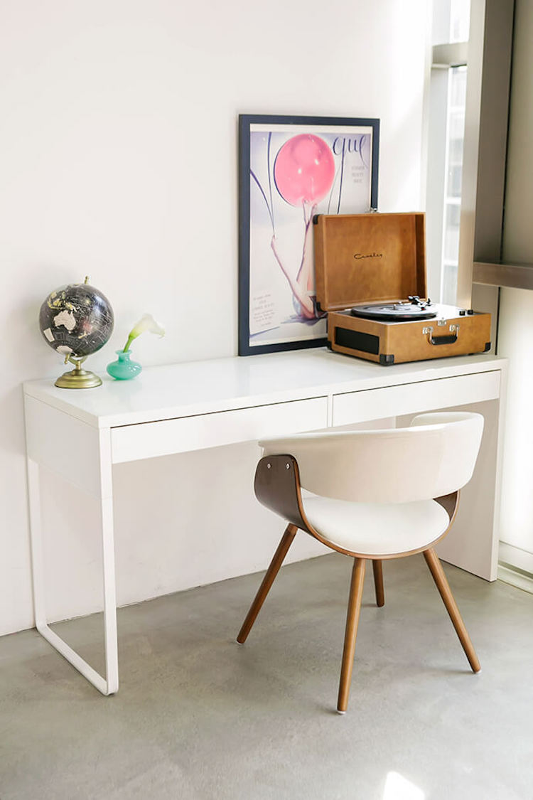 White mid-century office chair and desk