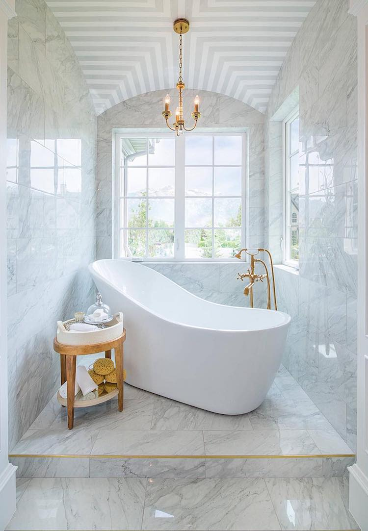 Brass and marble freestanding bathtub JCD Custom Home Design