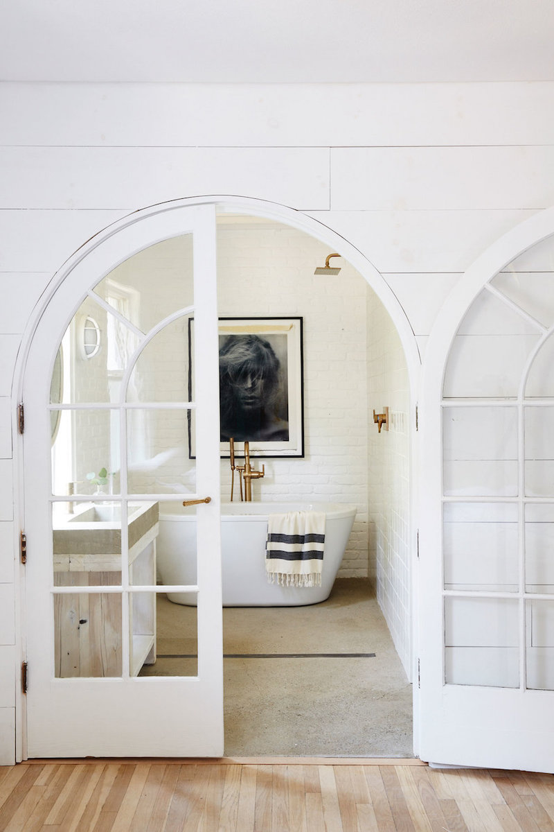 Master bath with freestanding white tub via nicole franzen
