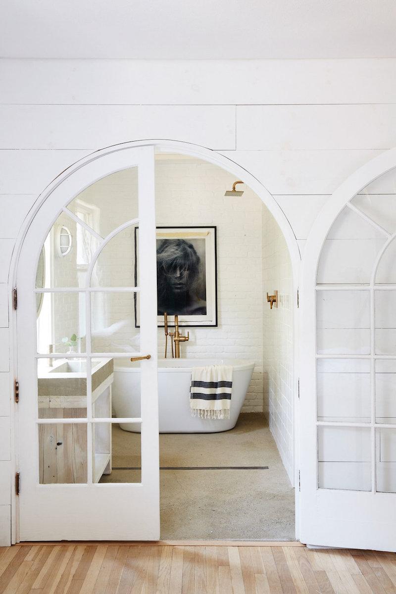 Master bath with freestanding white tub via nicole franzen