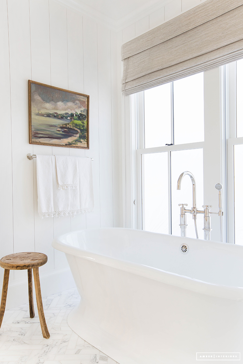 Simple white freestanding bathtub via amberinteriordesign