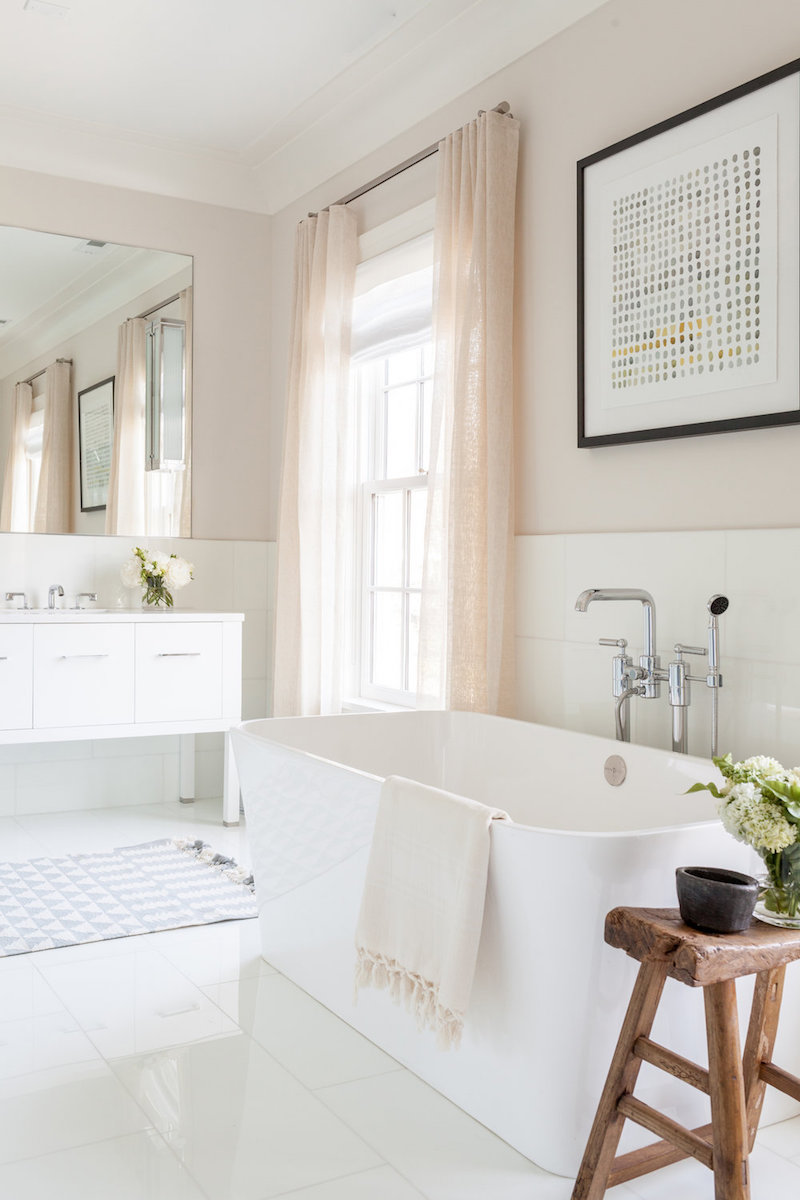 White bathtub in neutral bathroom via chango and co