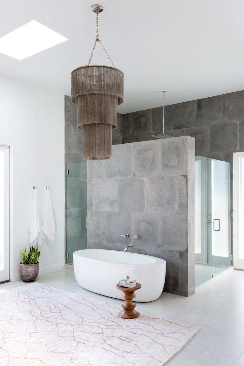 White tub with dark brown chandelier via Amy Elbaum