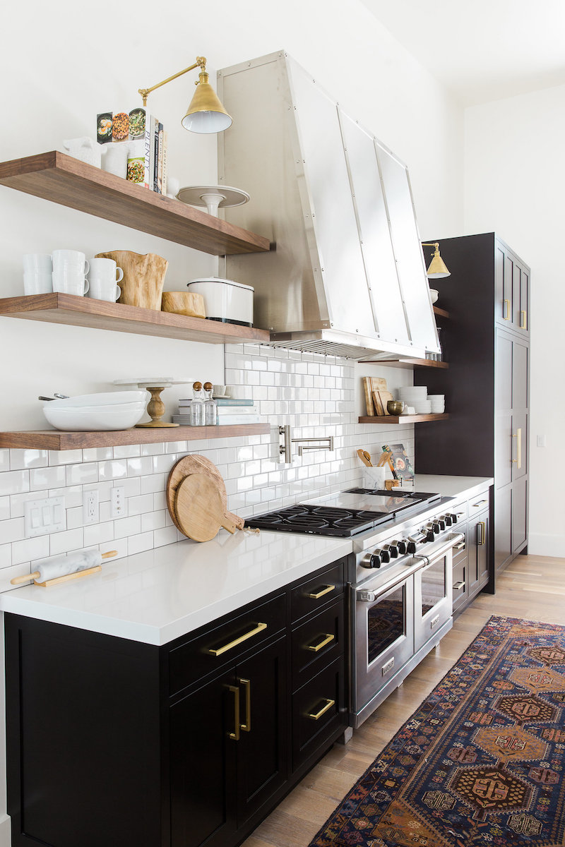 Black Kitchen Cabinets In Kitchen With Open Wood Shelving Via Studio McGee