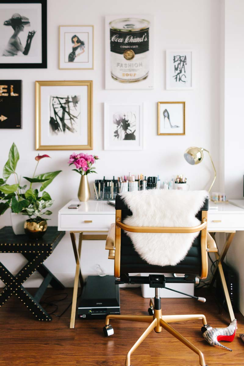 Brass gold and black office chair at desk via Jen Kay for the Everygirl