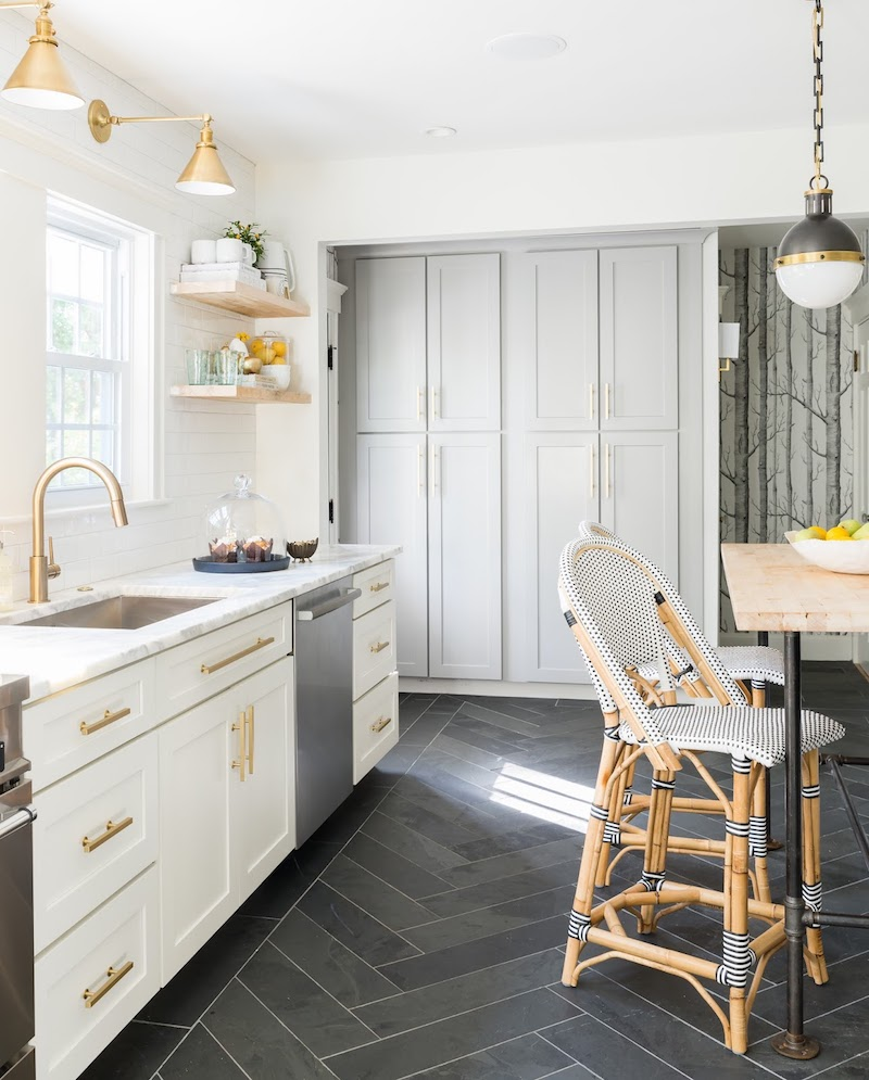 A Stunning Marble Kitchen with Gray Herringbone Floors & Brass Hardware