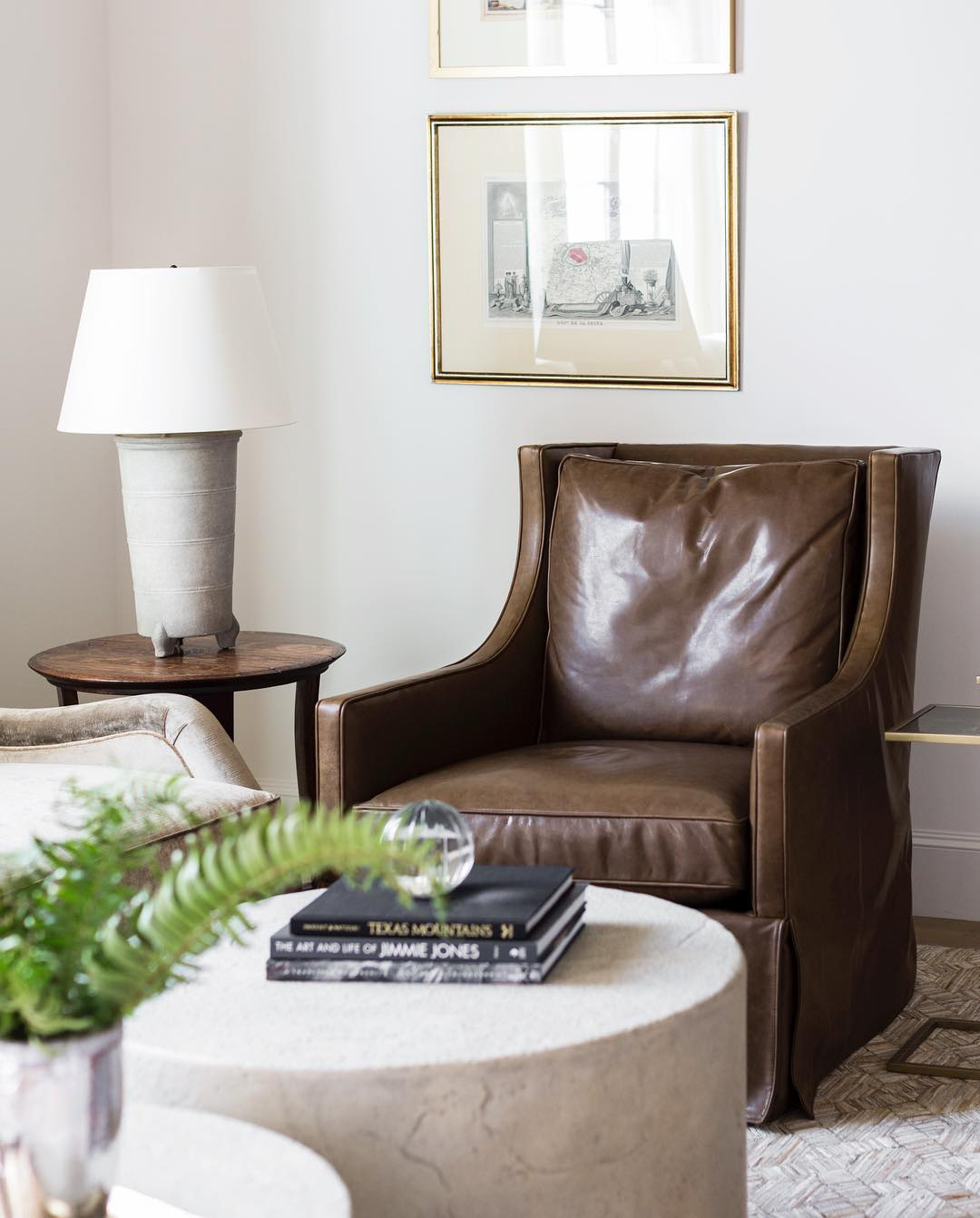 Brown leather accent chair via @marieflaniganinteriors