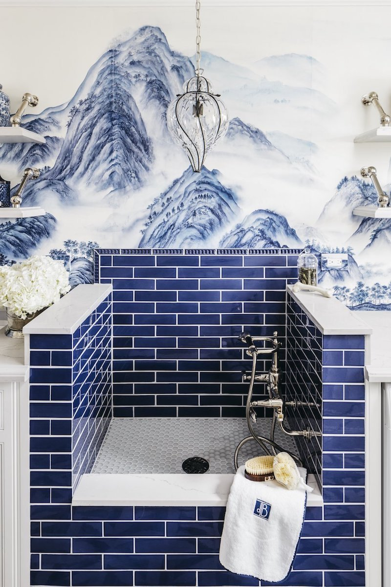 Cobalt blue tiled dog washing station with De Gournay chinoiserie wallpaper
