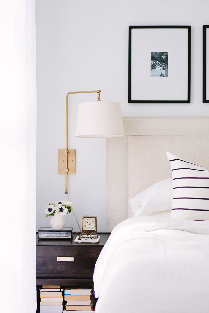 French-Inspired Bedroom Dark Nightstand and Gold Wall sconce
